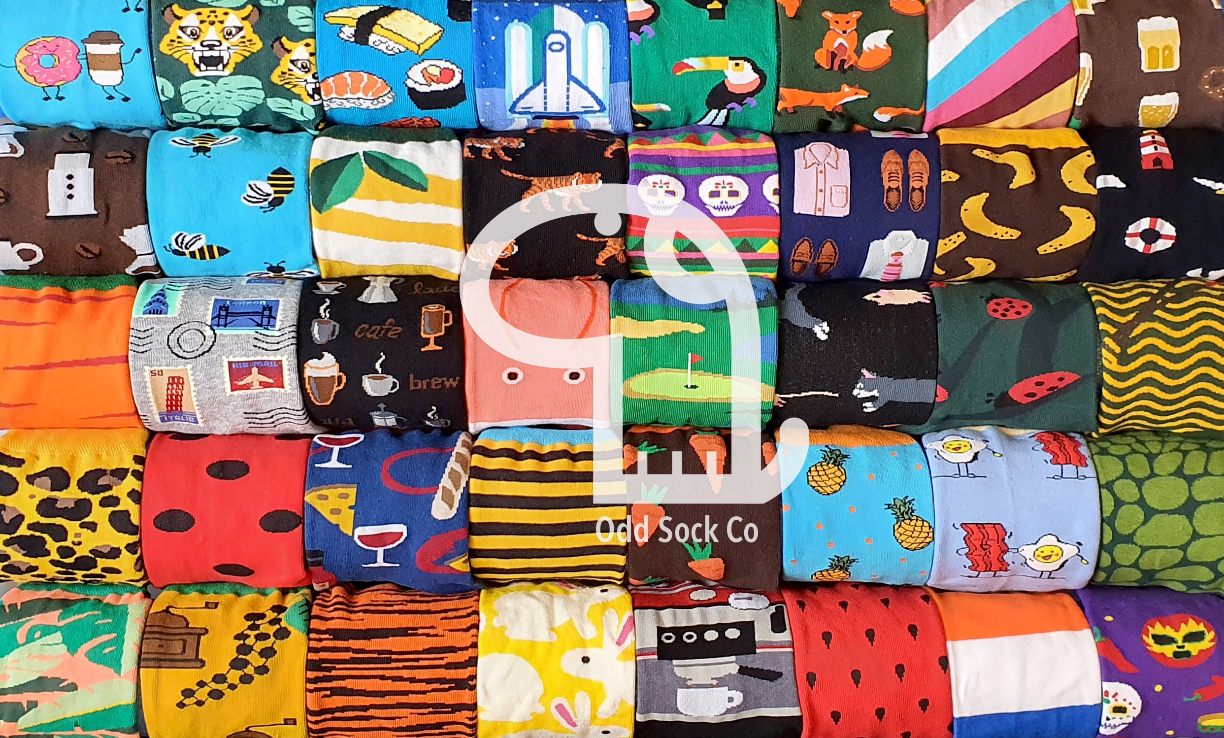 Oddy Oddsock logo on a photograph of rolls of socks